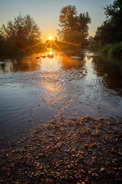 Sonnenstern am Fluß mit dem Nisi 15 mm